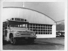 Bus in front of the garage